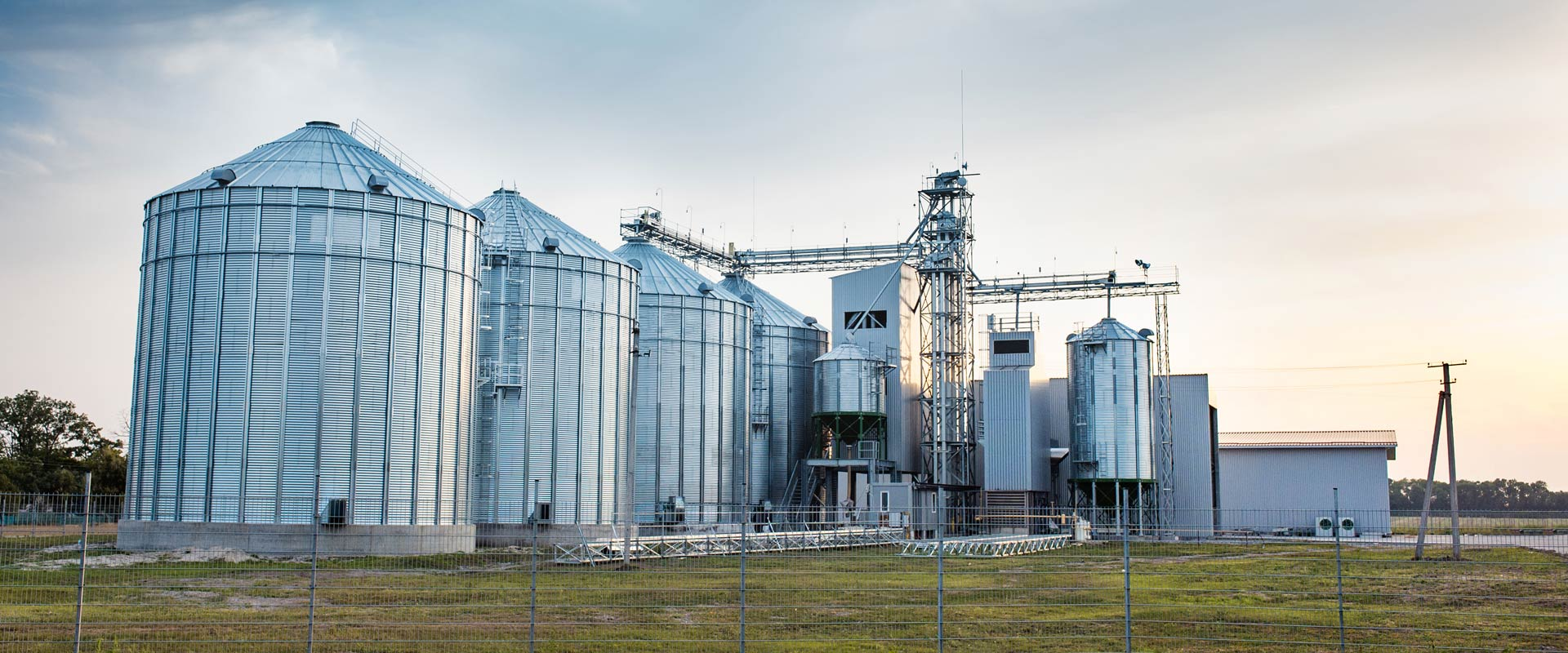 Iowa agribusiness insurance - grain bins on a farm